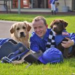 Jockey Stephen Baster with Vision Australia Seeing Eye Dogs