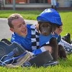 Jockey Stephen Baster with Seeing Eye Dog trainee Carson