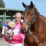 Jockey Glen Boss with Super Cool and Seeing Eye dog puppy at the launch of the 2014 Spring Racing Premierships